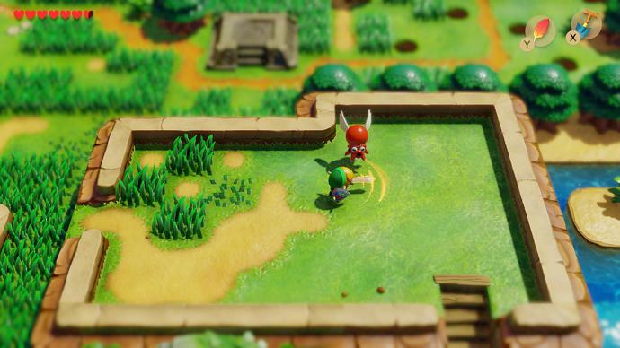 Link lucha contra un enemigo en un campo de hierba